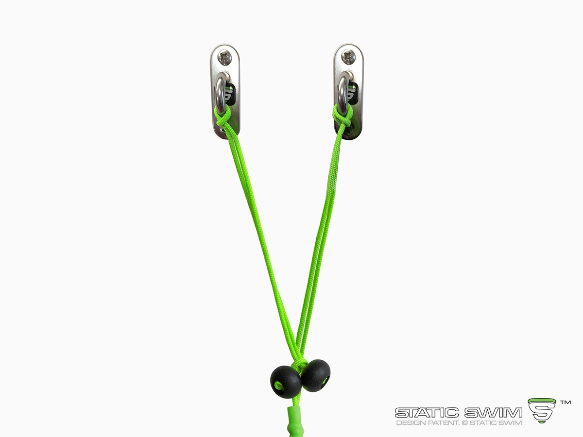Sophisticated and unique, the length of STATIC SWIM™ attachment device enables you to attach your equipment to any wall up to 7 meters from your pool. The length is adjusted by tying a simple knot at the stopper (black ball). The excess cord is then cut of